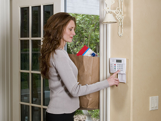 woman-disarming-security-alarm-542x