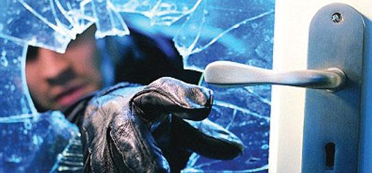 gloved-hand-smashing-glass-door-reaching-for-handle-542x
